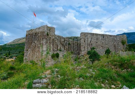 Walls of ancient citadel with view of mountains Old Bar Montenegro