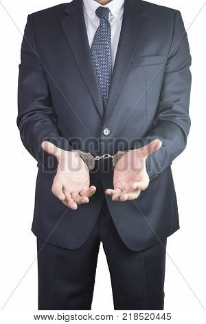 handcuffs for businessman going to jail. justice - concept justice and crime concept