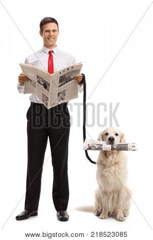 Full length portrait of an elegant guy with a newspaper and a labrador retriever dog with a newspaper isolated on white background