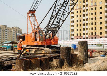 Tyumen, Russia - July 31, 2013: JSC Mostostroy-11. Bridge construction for outcome of Melnikayte street and Shirotnaya streei in Tyumen. Construction of the underground crosswalk