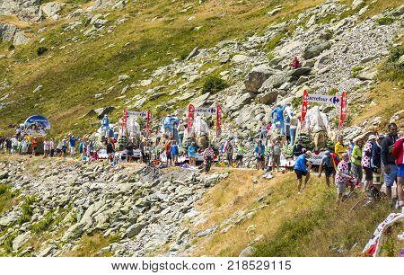 Col de la Croix de Fer France - 25 July 2015: Spectators during the passing of the Publicity Caravan on the roadside to the Col de la Croix de Fer in Alps during the stage 20 of Le Tour de France 2015.