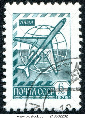 USSR - CIRCA 1976: A stamp printed in the USSR shows the Globe and jetliner Tu-154 circa 1976