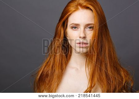 Beautiful long red health hair of young attractive woman