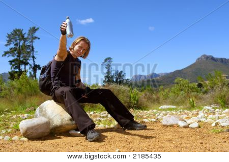 Cheers! - Young Man Rises A Waterbottle
