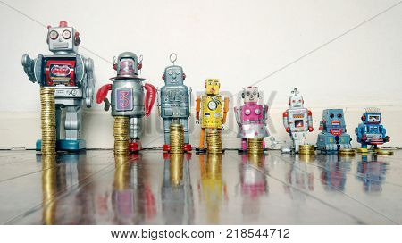 A line of retro toys with staks of gold coines on a wooden floor concept