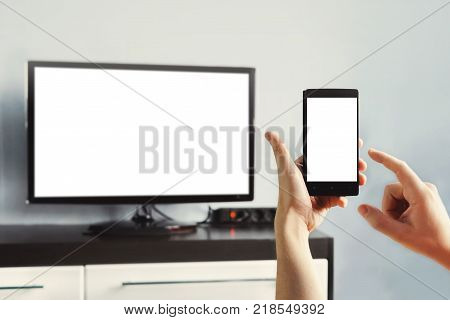Closeup On Woman Hand Holding Smartphone And Use A App With Remote Control.