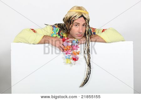 Bored man in hippie costume