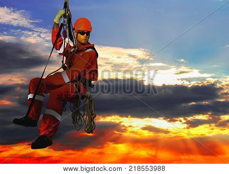 Mannequin in overalls steeplejack on cloudy sky background