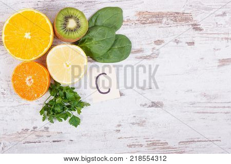 Fruits and vegetables as sources vitamin C natural minerals and dietary fiber healthy food and strengthening immunity concept copy space for text on rustic board