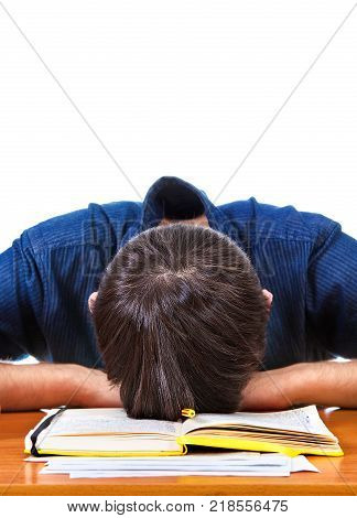 Tired Young Man sleep on the Book on the White Background