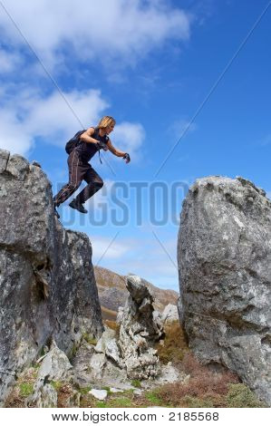 Young Man Jumps From Rock