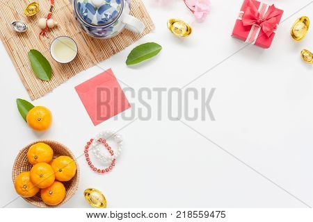 Above view image shot of accessories on Lunar New Year & Chinese New Year holiday background concept.free space for mock up & Template.Mix objects on modern design white wooden at home office desk.