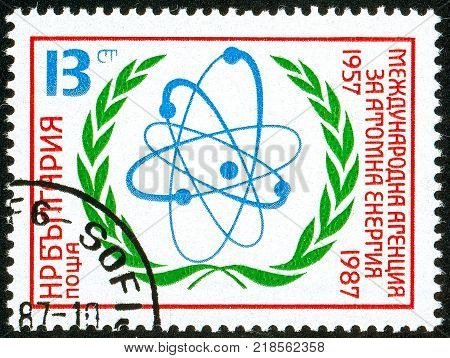 UKRAINE - circa 2017: A postage stamp printed in Bulgaria shows Atomic model Series 30 years International Atomic Energy Agency MAGATE IAEA circa 1987