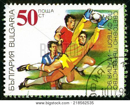 UKRAINE - circa 2017: A postage stamp printed in Bulgaria shows World Football Championship Italia 1990 Series World Cup Football circa 1990