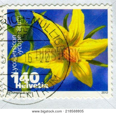 GOMEL, BELARUS, 9 DECEMBER 2017, Stamp printed in Switzerland shows image of the Lycopersicon was a genus in the flowering plant family Solanaceae (the nightshades and relatives), circa 2012.