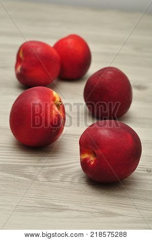 Nectarines on a table with shallow dept of field