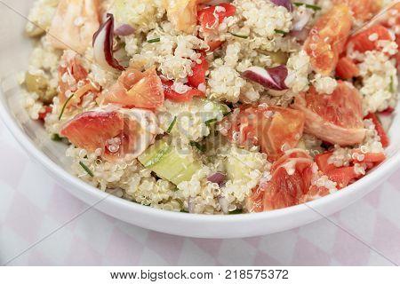 Quinoa salad with blood orange, radicchio, cucumber and olives