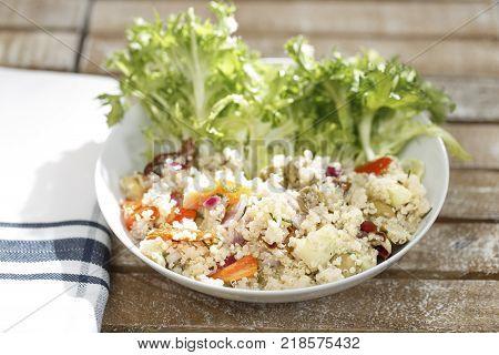 Fries salad with Quinoa, radicchio, cucumber and olives