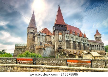 Beautiful panorama of the Corvin castle with wooden bridge and bench, Hunedoara, Transylvania, Romania, Europe