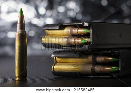 Cartridges for NATO rifles with a pair of magazines