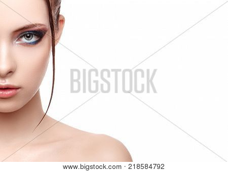 Half-face portrait of beautiful sensitive woman with fresh clean skin wet effect on her face and body high fashion and beauty portrait creative makeup theme strobing or highlighting makeup