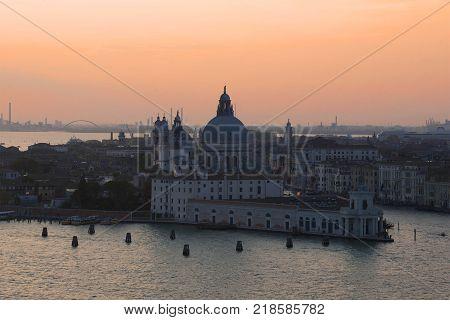 Punta della Dogana Gallery and Santa Maria della Salute сathedral on sunset. Venice