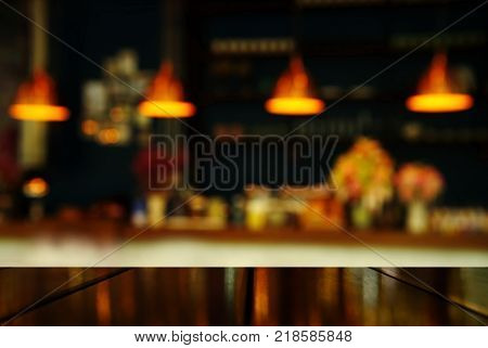 top of table with blur light lamp of counter bar or club at night for party or celebrate background