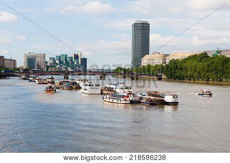 Boats on River Thames before Lambeth Bridge, London, England