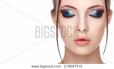 Half-face portrait of sensitive woman with perfect fresh clean skin wet effect on her face and body high fashion and beauty portrait creative makeup theme strobing or highlighting makeup