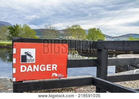 FORT WILLIAM , SCOTLAND - MAY 19 2017 : Sign by british waterways warning of the danger of falling into the water