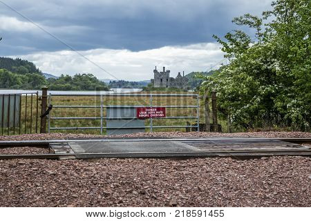 LOCH AWE, ARGYLL, Scotland - MAY 15 2017 : Sign with instructions how to tresspass the railway
