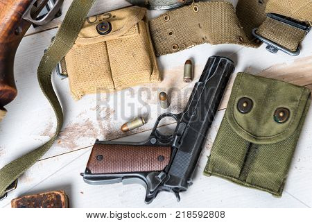 an handgun M1911 government with the ammo