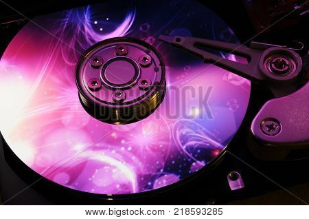 Close Up of Open Hard Disk Drive with color effects on the disk surface