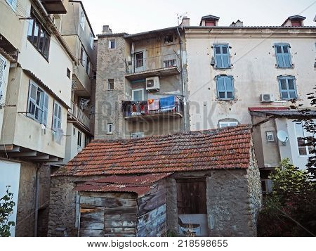 view on yard at old rental houses in corte city corsica with balcony and hanging clothes