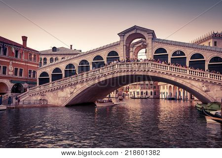 Rialto Bridge over the Grand Canal in the evening in Venice, Italy. Rialto Bridge (Ponte di Rialto) is one of the main tourist attractions of Venice.