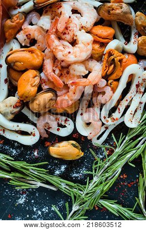 Seafood mix on dark background. Asian cuisine. Healthy eating. Diet food concept