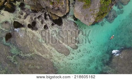 Surfing Aerial, Aerial top view of Beach with ocean waves in Bali, Indonesia