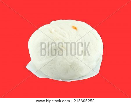close-up steamed stuff bun (Chinese bun) isolated on red background, traditional Chinese food or snack made from stuffed dough and then steamed, part of dim sum cuisine