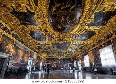 Venice, Italy - May 20, 2017: Interior of the Doge`s Palace (Palazzo Ducale) the Higher Council Hall. Doge`s Palace was built in 15th cent on St Mark`s Square and is one of the main tourist attractions of Venice.