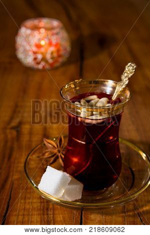 Tunisian tea in traditional glass over a wooden background