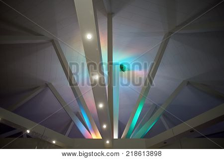 Abstraction. Beams under Polycom with coloured lights. Beautiful rich colors