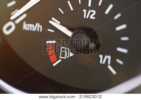 Car fuel gas tank meter close up on modern car dashboard