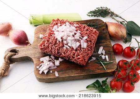 Raw pork and beef ground meat and vegetables