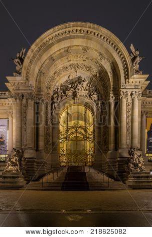 PARIS, FRANCE - DECEMBER 02, 2017: The Petit Palais at dusk in Paris France. The Petit Palais (Small Palace) is a museum in Paris France