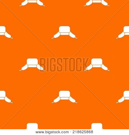 Hat with ear flaps pattern repeat seamless in orange color for any design. Vector geometric illustration