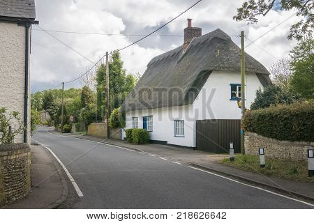 Street view of a thatched cottage in the pretty village of Fowlmere Cambridgeshire England UK