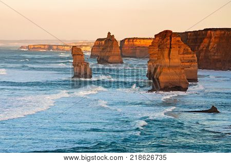 Sunrise over Twelves Apostles in Great Ocean Road Victoria Australia. The Twelve Apostles is a collection of limestone stacks off the shore of the Port Campbell National Park.