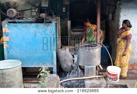 MUMBAI, INDIA - JANUARY 12, 2016: Indian women washing clothes at Dhobi Ghat a well know open air laundromat in downtown of Mumbai in Maharashtra State