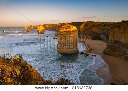 Sunrise over Twelves Apostles in Great Ocean Road, Victoria, Australia. The Twelve Apostles is a collection of limestone stacks off the shore of the Port Campbell National Park.