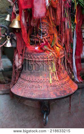 Beautiful big bronze bell with sacred carvings in a hindu temple in Kathmandu Nepal